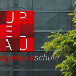 Kuppelnau-Schule – Beschriftung an Aussenfassade
