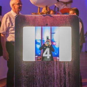 Die Fotobox: eine lustige Erinnerung an eine tolles Fest. Im Hintergrund Ministerpräsident Winfried Kretschmann